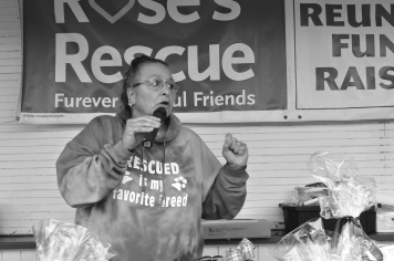An announcer working at a charity event for a dog rescue organization.
