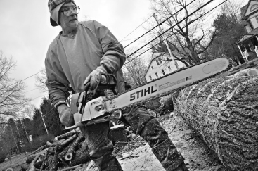 """""""William, a tree cutter, wielding an enormous chain saw."""""""