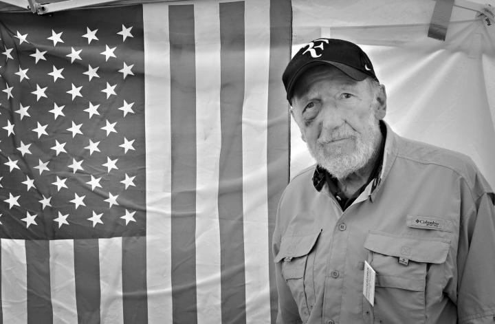 Man by the flag of the USA